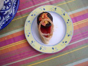 Tapa de Morcilla con pimientos.